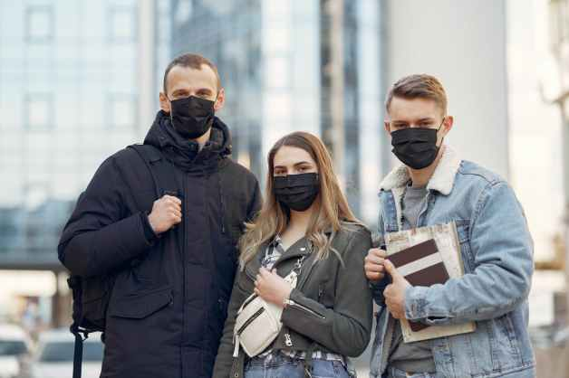 group of people wearing black face mask